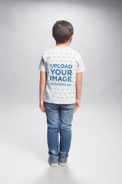 Transparent T-Shirt Back Shot Mockup of a Kid Standing in a Photo Studio a20942