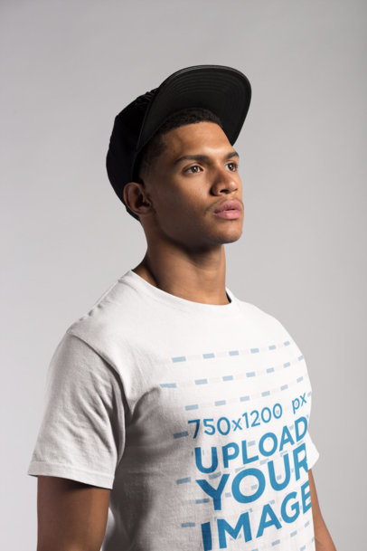 Transparent Angled Shot of a T-Shirt Mockup Featuring a Young Man with a Hat 21071