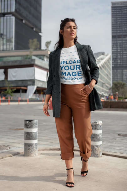 Transparent Round Neck Tee Mockup of a Girl Walking by a Financial Center 22685