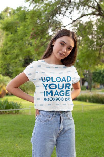 Transparent Crop Top Mockup of a Young Woman at a Park 28565