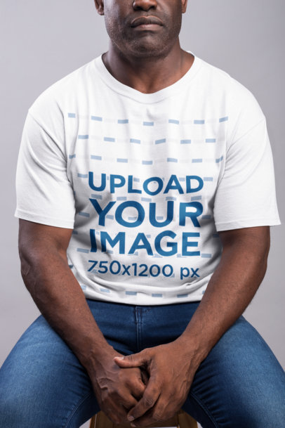 Transparent Mockup of a Strong Serious Man Wearing a T-Shirt  21485
