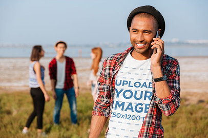 Transparent Round-Neck Tee Mockup Featuring a Smiling Man Talking on His Mobile 34851-r-el2