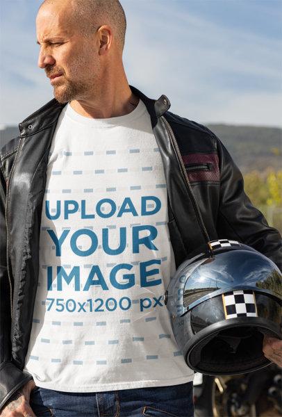 Transparent T-Shirt Mockup Featuring a Biker Holding His Helmet 31787