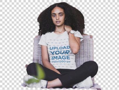 Transparent Mockup of a Woman Wearing a T-shirt and Sitting on a Wooden Chair 20417