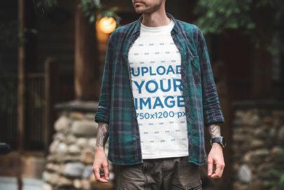 Transparent Mockup of a Tattooed Man Wearing a T-Shirt Outside 1847-el1