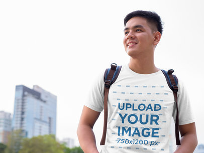Transparent T-Shirt Mockup Featuring a Young Man in the City 40513-r-el2