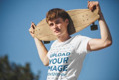 Transparent Round-Neck Tee Mockup of a Man Holding a Skateboard 37873-r-el2