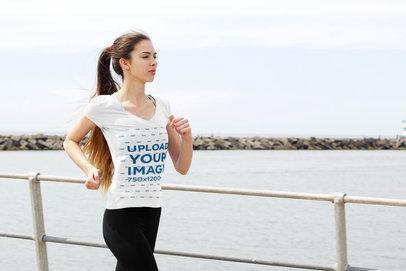 Transparent V-Neck Tee Mockup of a Female Jogger by a Pier 34801-r-el2