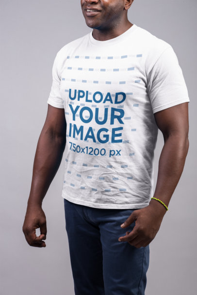 Transparent Mockup of a Smiling Man Wearing a T Shirt and Blue Trousers 21488