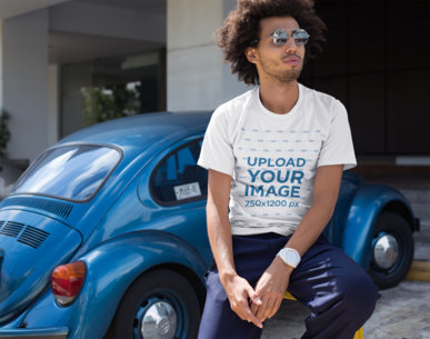 Transparent T-Shirt Mockup of a Man with an Afro Leaning on a Parking Rail 22258