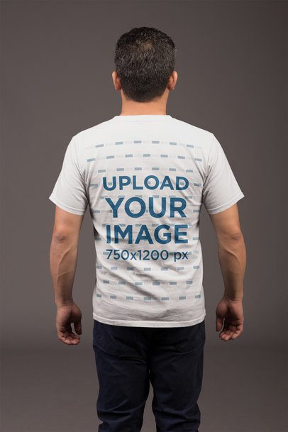 Transparent Back Shot Tee Mockup of a Man with a Grey Background 21234