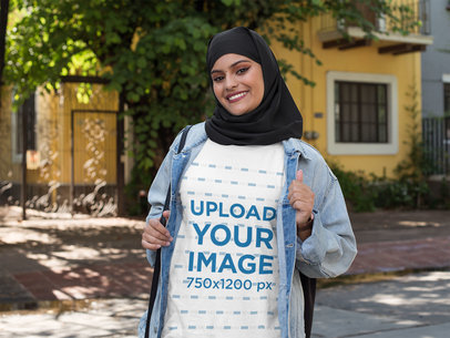 Transparent T-Shirt Mockup of a Woman With a Hijab Walking on the Street 28410
