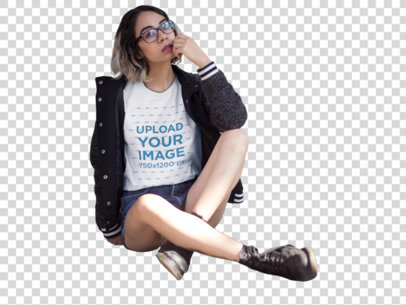 Transparent Hipster Hispanic Woman Wearing a Round Neck Tee While Sitting Down Outdoors Mockup a13562