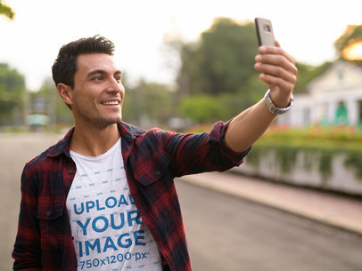 Transparent Selfie Mockup Featuring a Man Wearing a Basic T-Shirt on the Street 40448-r-el2