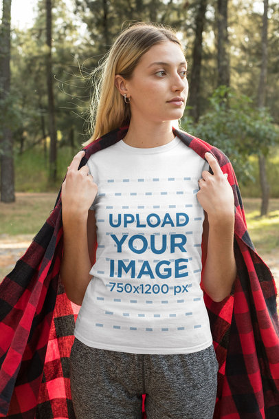 Transparent T-Shirt Mockup of a Young Woman Covering Her Back From the Cold 32243