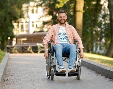 T-Shirt Mockup of a Man Using a Wheelchair at a Park M17375-r-el2