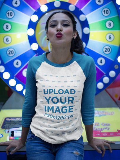 Pretty Girl Wearing a Raglan Tee Mockup while Sending a Kiss Against a Fortune Roulette a17521
