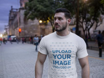 Handsome Buff Man Wearing a Round Neck T-Shirt Mockup While Walking on the Boulevard a17686