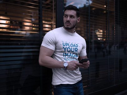Handsome Man Wearing a Tshirt Mockup While Waiting for his Date a17663
