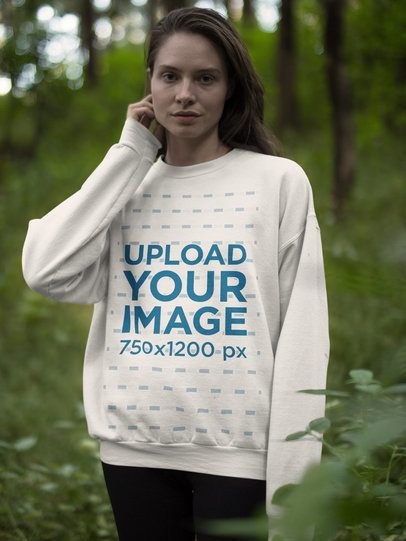 White Woman Wearing a Crew Neck Sweatshirt Template While in the Woods a17910