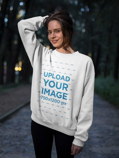 Beautiful Happy Woman Wearing a Crew Neck Sweatshirt Template in the Forest a17917