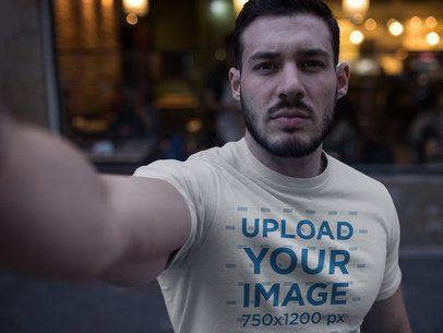Selfie of a Buff Dude Wearing a T-Shirt Mockup a17665