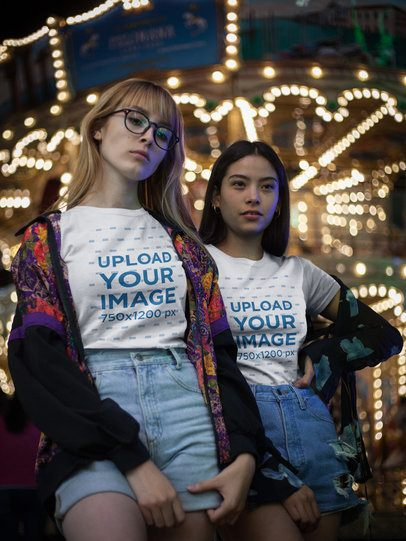 Trendy Girls Wearing Round Neck Tees Mockup While Near a Carousel a17882