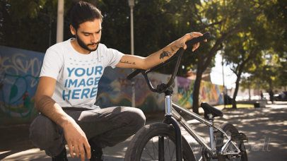 Trendy Young Man With His Bicycle Wearing a T-Shirt Cinemagraph a13369