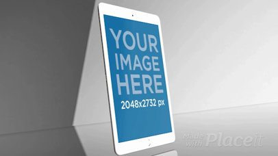 Angled White iPad Video Standing in a Gray Room a15794