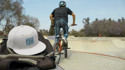 Biker Boy in a Skatepark Leaving His Snapback Hat Video Mockup on His Backpack a14195