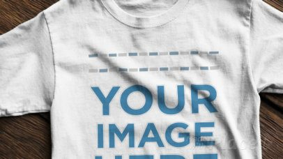 T-Shirt Video Mockup on a Wooden Table a12347