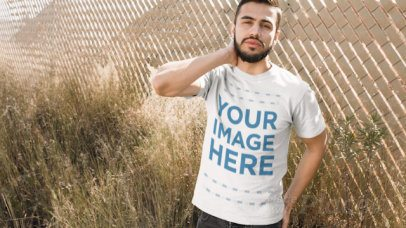 Young Hispanic Man Wearing a Tshirt Cinemagraph Mockup Outdoors a13471