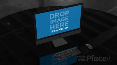 iMac Video Standing on a Table in a Dark Room a16242b