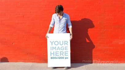 Man Being Funny Holding a Poster Against a Red Wall in Stop Motion a13658