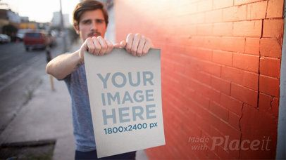 Stop Motion of a Poster Held by a Trendy Hipster Man In The Street a13653b