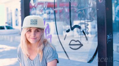 Young Skater Girl Wearing a Snapback Hat Video while Sitting on a Bus Stop a14138