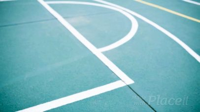 Basketball Jersey Maker - Video of a Jersey Lying on a Green Court a16938