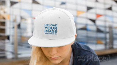 Young Woman Wearing a Snapback Hat Video Mockup While in the City a14143