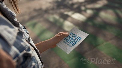 Girl Walking While Holding a Flyer in Stop Motion a13753