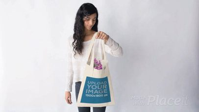 Young Pretty Girl with a Tote Bag Stop Motion Filled with Purple Flowers a13670