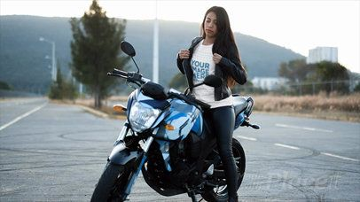 Trendy Girl Wearing a Round Neck Tee in Stop Motion and a Leather Jacket on her Bike a13580