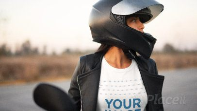 Edgy Girl Outdoors Wearing a T-Shirt in Stop Motion Getting Ready to Ride her Motorcycle a13582