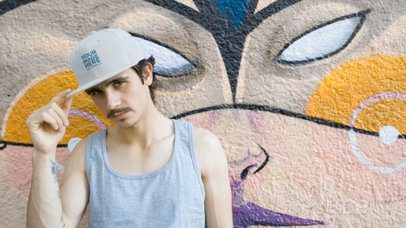 Hipster Man with Mustache Wearing a Snapback Hat Video Near a Graffiti a14160