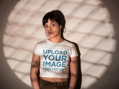 Woman Wearing a Crop Top Tshirt Mockup Facing a Light a19422
