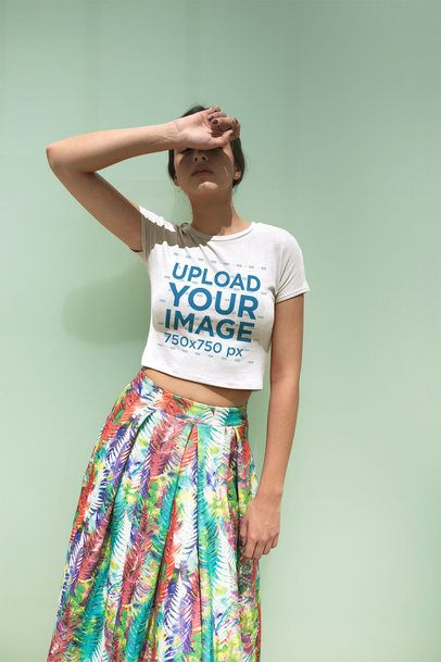 Girl Blocking the Sun Wearing a T-Shirt Mockup and a Colorful Skirt a19538