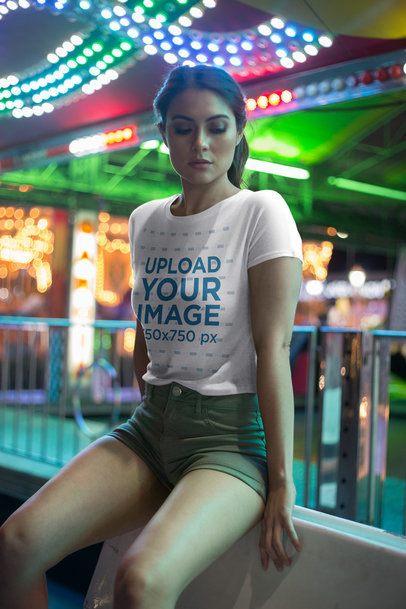 Beautiful Girl Wearing a Tshirt Mockup at an Amusement Park a19450