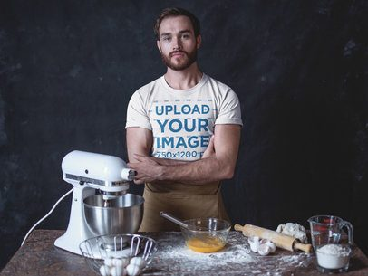 T-Shirt Mockup of a Baker Standing in Front of his Work Table a20270