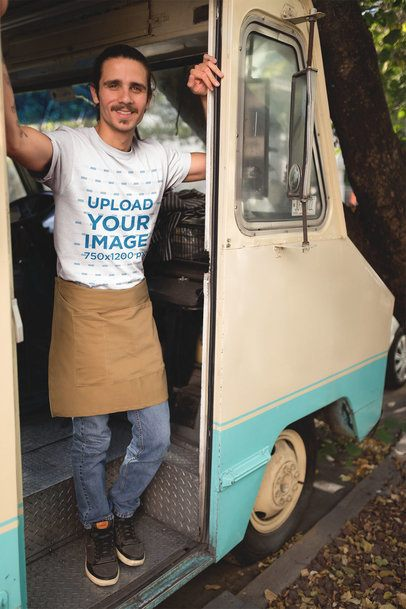 Man Smiling Wearing a T-Shirt Mockup Leaning Against his Food Truck Door a20305