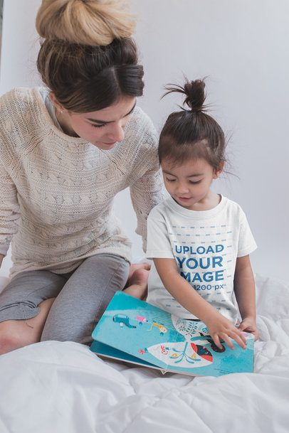Mockup of a Girl Wearing a T-Shirt Reading with her Mom a20275