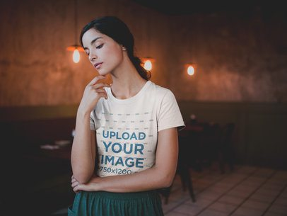Mockup of a Beautiful Woman Wearing a T-Shirt at a Restaurant a20097